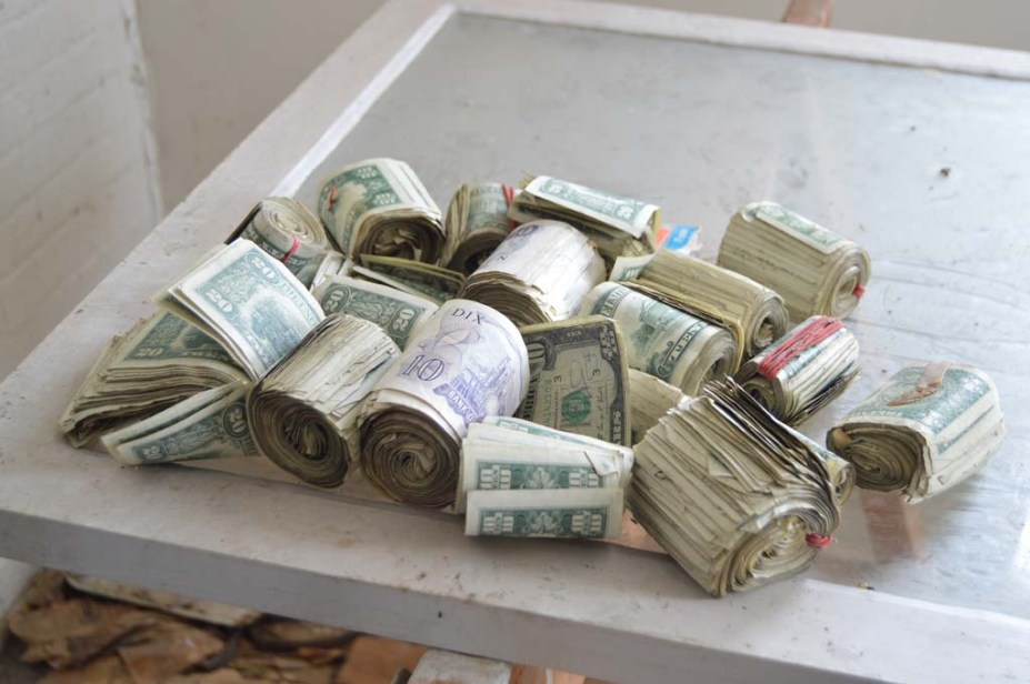 Photographer Finds stash of money in an abandoned house