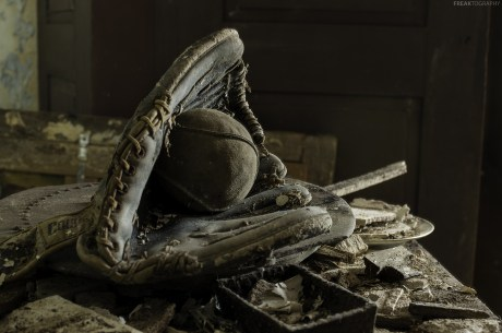 An old baseball inside a very old baseball glove found inside an abandoned house in Ontario.