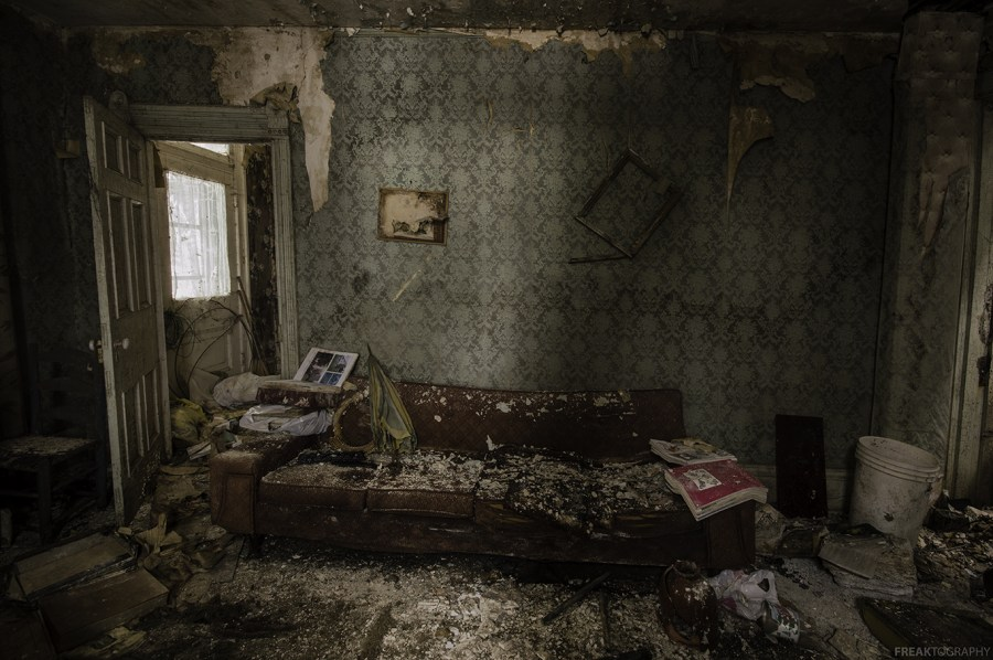 Badly decaying bedroom in an abandoned house