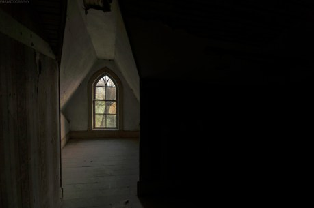 A beautiful window in the attic level of an abandoned house in Ontario.