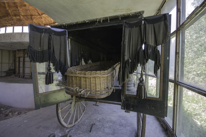 A wicker casket inside a hearse carriage found inside a very unique vacant house in Ontario.