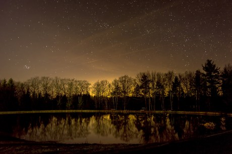 Trees reflecting in the fishing pond at the Rushford Lake Conservation Club
