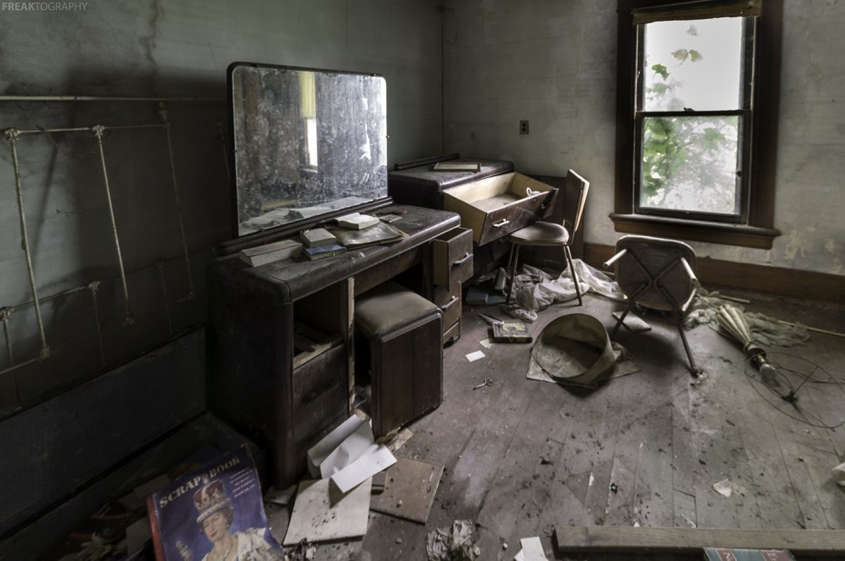 One of the upstairs bedrooms of a badly decayed abandoned ontario house