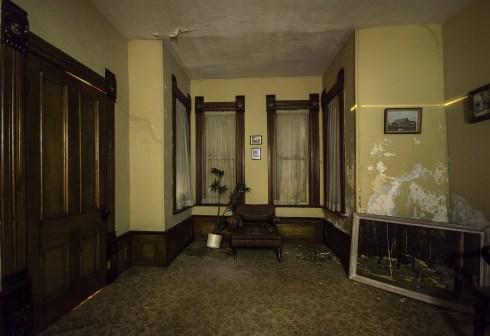A dark living room in an abandoned Ontario house.