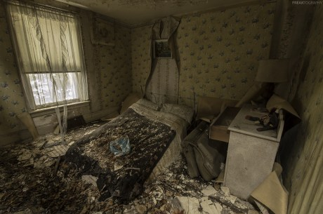 In an abandoned house that has begun crumbling into itself, here is one of the upstairs bedrooms.