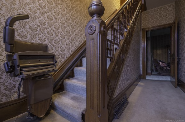 A stairlift and a great staircase Inside an abandond ontario house