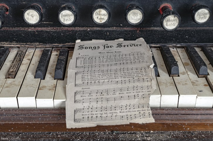 sheet music in an abandoned church