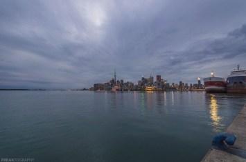 clouds, cn tower, dark sky, lake ontario, night, night photography, ontario, skyline, toronto advertising, toronto ontario, toronto skyline, water