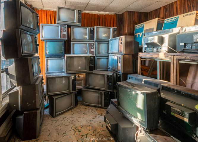 abandoned 1980s hotel stacked televisions