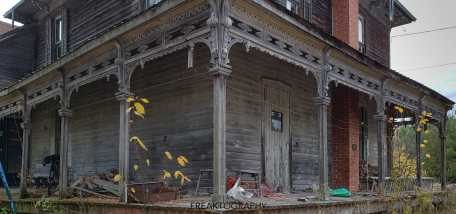 authentic abandoned time capsule house of horrors-decaying front porch