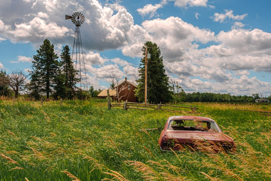 abandoned car and farm in rural ontario