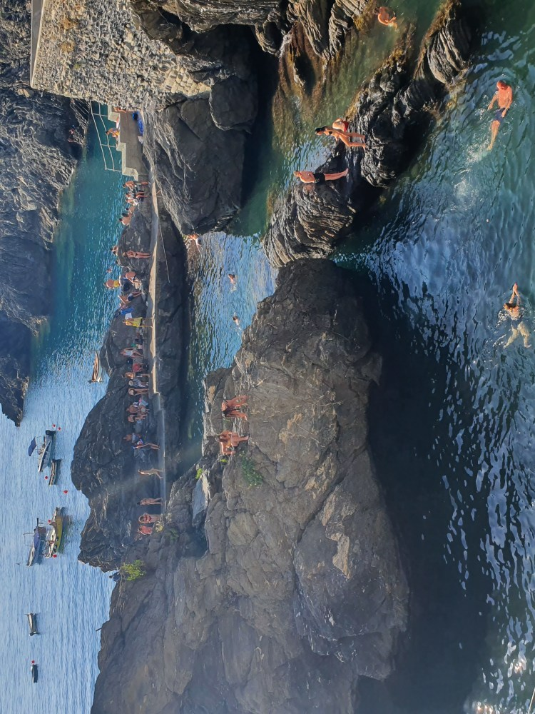 Swimming lagoons and cliff jumps in Manarola in Cinque Terre, Italy.
