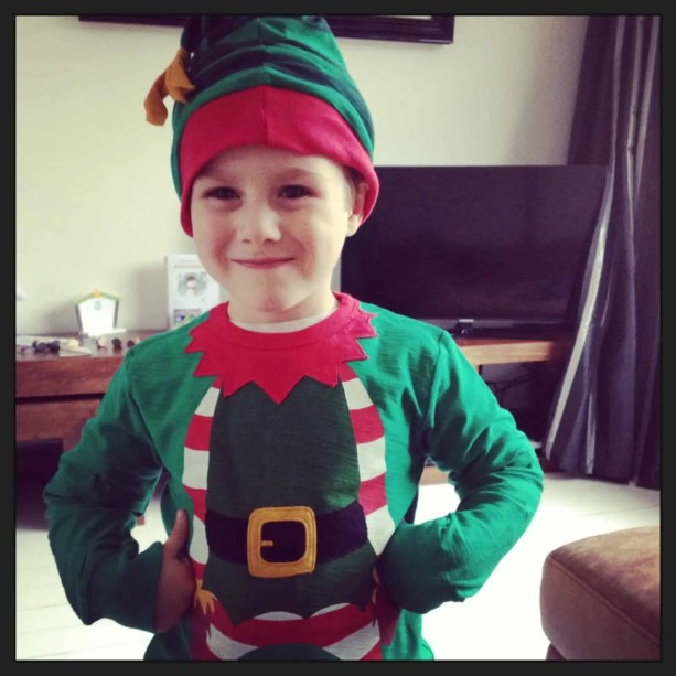 Elf on the Shelf Bringing Christmas Jumpers
