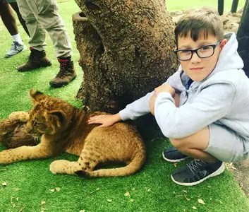 Playing with lions at Casela Safari Park