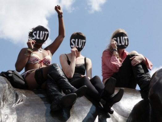 117265-slutwalk-participants-cheer-a-speaker-after-walking-from-hyde-park-cor.jpeg