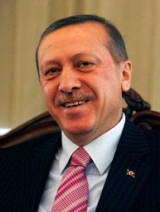 Erdogan smiles.  I wanted a picture here of Erdogan and Öcalan together, but it's not available (yet?).