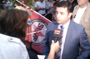Selahattin Demirtas talks to CNN Türk, defending his call for people to protect themselves. Picture taken on Tuesday 21 July at the place of the Suruc massacre. Photo: Fréderike Geerdink