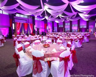 This is an event photograph of an immense ballroom that shows Fred Ferris Photography brings a depth of experience to handle mixed lighting conditions.