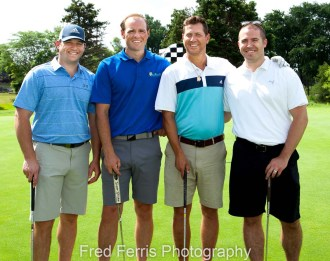 Example photo showing a group of four golfers. We do same day or next day photo delivery for time-sensitive events such as golf outings and ribbon cuttings.