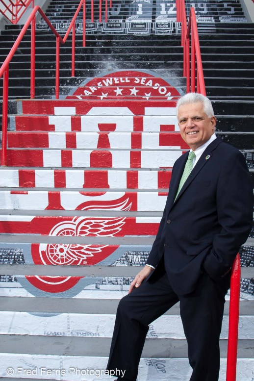 This is a professional portrait of a man to show that we guide you on choosing the right location. This portrait shows a lifetime Red Wings fan at Joe Louis Arena!