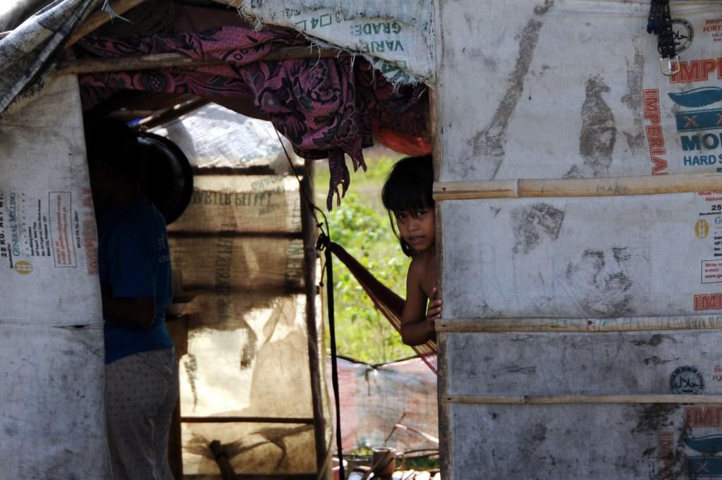 Displaced girl peeking