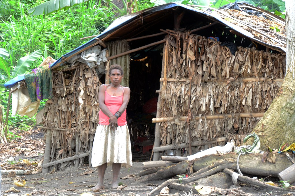 Woman in front of her house