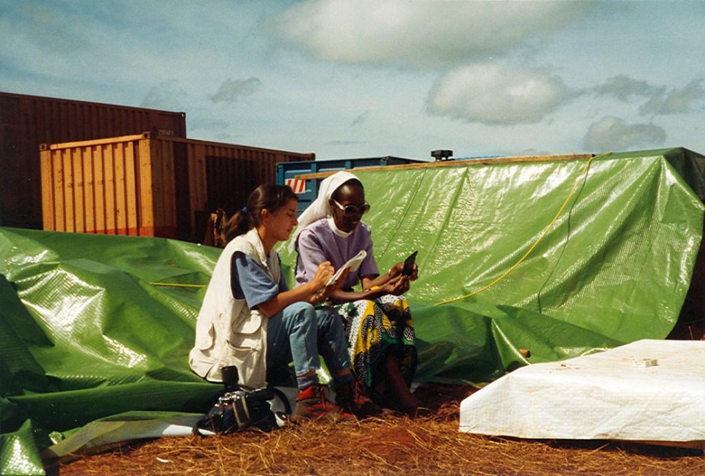 journalist interviewing a refugee from Rwanda
