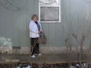 Image of the exterior bedroom window in which the intruder entered Christina McNeil's room and murdered her. Misook Wang is the same height as this person depicted in the picture and being slight, in her 30s and physcially fit, and given the large wooden window frame in the inside, once the aluminum screen was removed, could have easily hoisted herself inside.