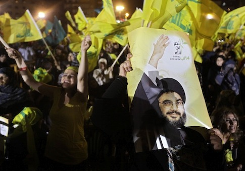 Hezbollah supporters wave the party's flags in 2011 / AP