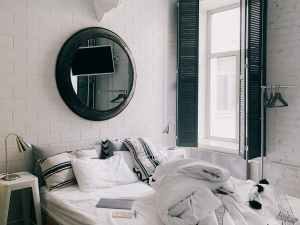 stylish bedroom interior in black and white colors