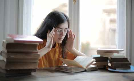 female student suffering from headache in libraryWhat Your Headache Might Be Telling You