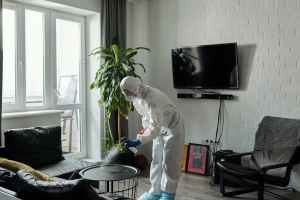 person cleaning the living room