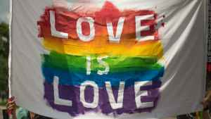 white and multicolored love is love banner