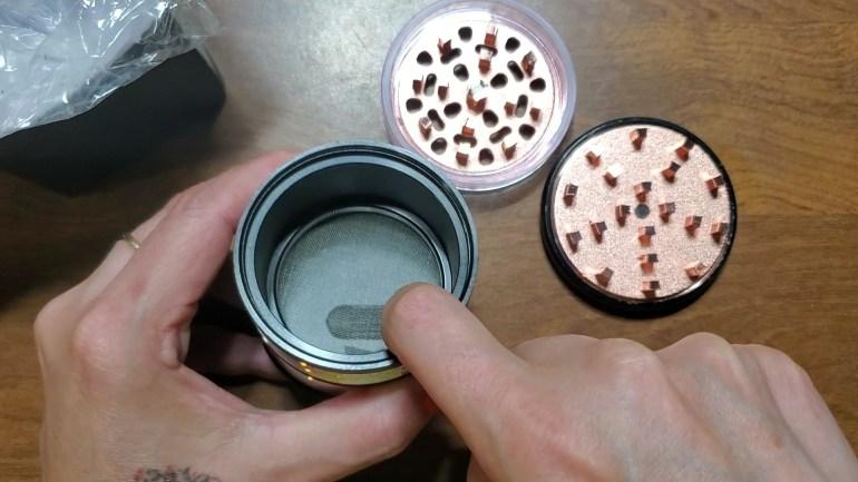 grinder holding chamber