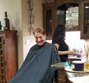 May 4, 2018: Charlie Thrash enjoys some in-home hair pampering from licensed beautician & daughter, Michelle Martinez