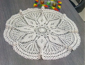 Crochet tablecloth on top of a table made with free graphic