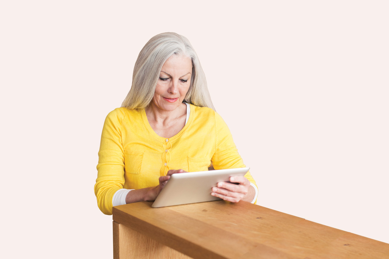 Woman uses a tablet to email FREED