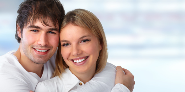young couple embracing happy