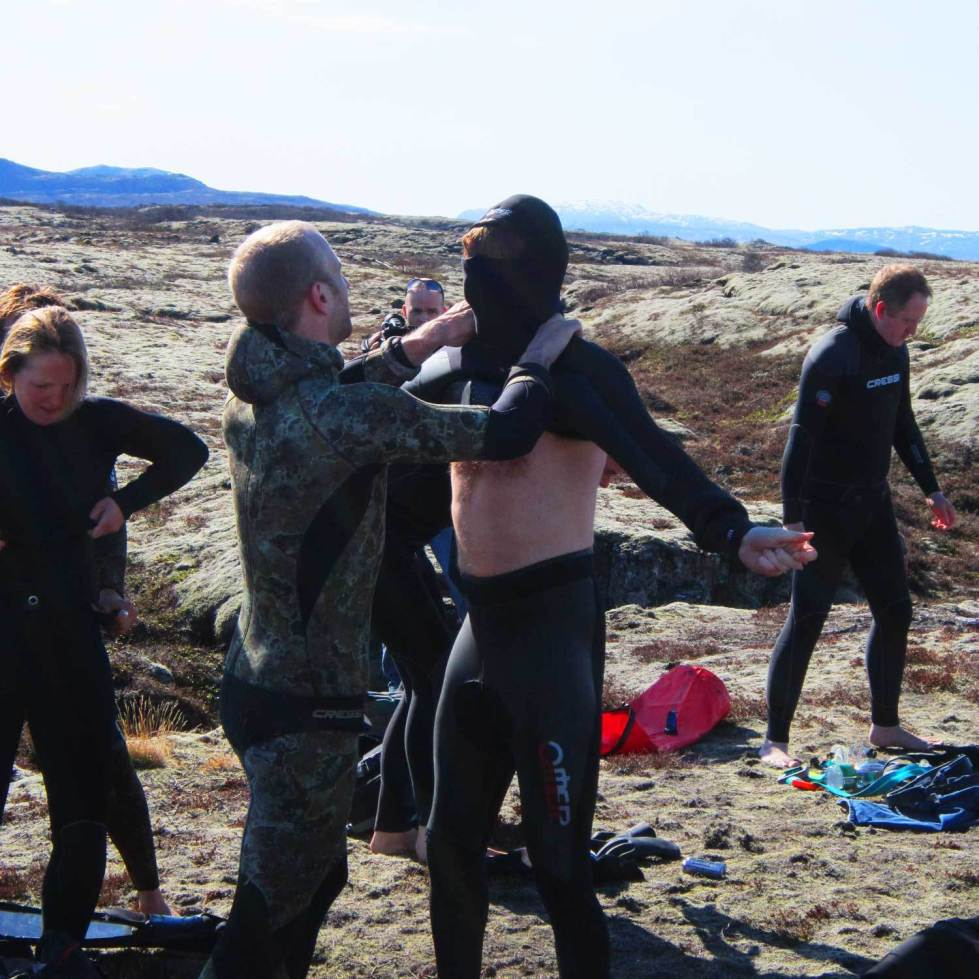 put on a freediving wetsuit
