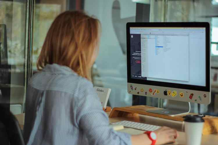 Woman focused and on-task at computer