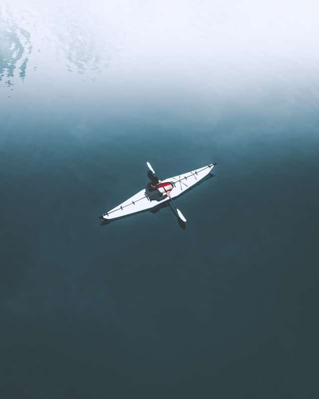 Embrace solitude - person in kayak