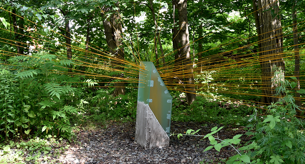 "Node Hissed by Freedom Baird installed in Studios Without Walls ""Beyond Boundaries"" exhibition, Upper Falls Greenway, Newton, MA, Summer 2018. Photograph courtesy of Wendy Wolf"