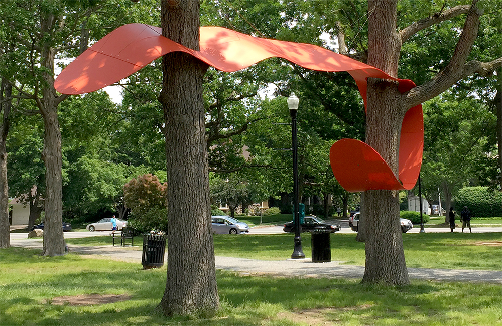 Two Oaks Spanner, 2015. Freedom Baird. Coroplast, plastic and metal hardware, nylon cord. 12 x 4 x 30 feet. Installed in Elm Park, Worcester, MA for Art in the Park 2015.