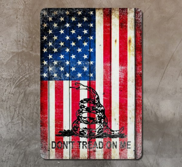 American and Gadsden Flag mix Vertical print on Metal displayed on concrete