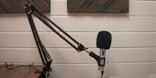 microphone boom arm for a podcast recording studio