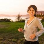 A happy woman walking outdoors.