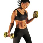 A woman lifting dumbbells.