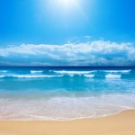 The sun shining on a beach.