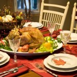 A table containing a Christmas dinner.
