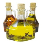 3 glass bottles of olive oil.
